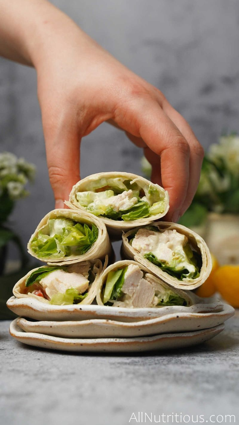 stack of chicken salad wraps on plate