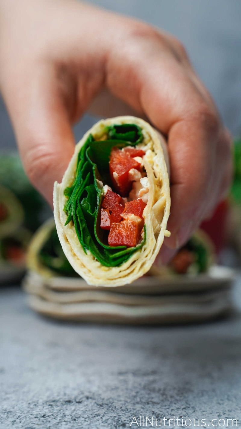 holding spinach feta wrap