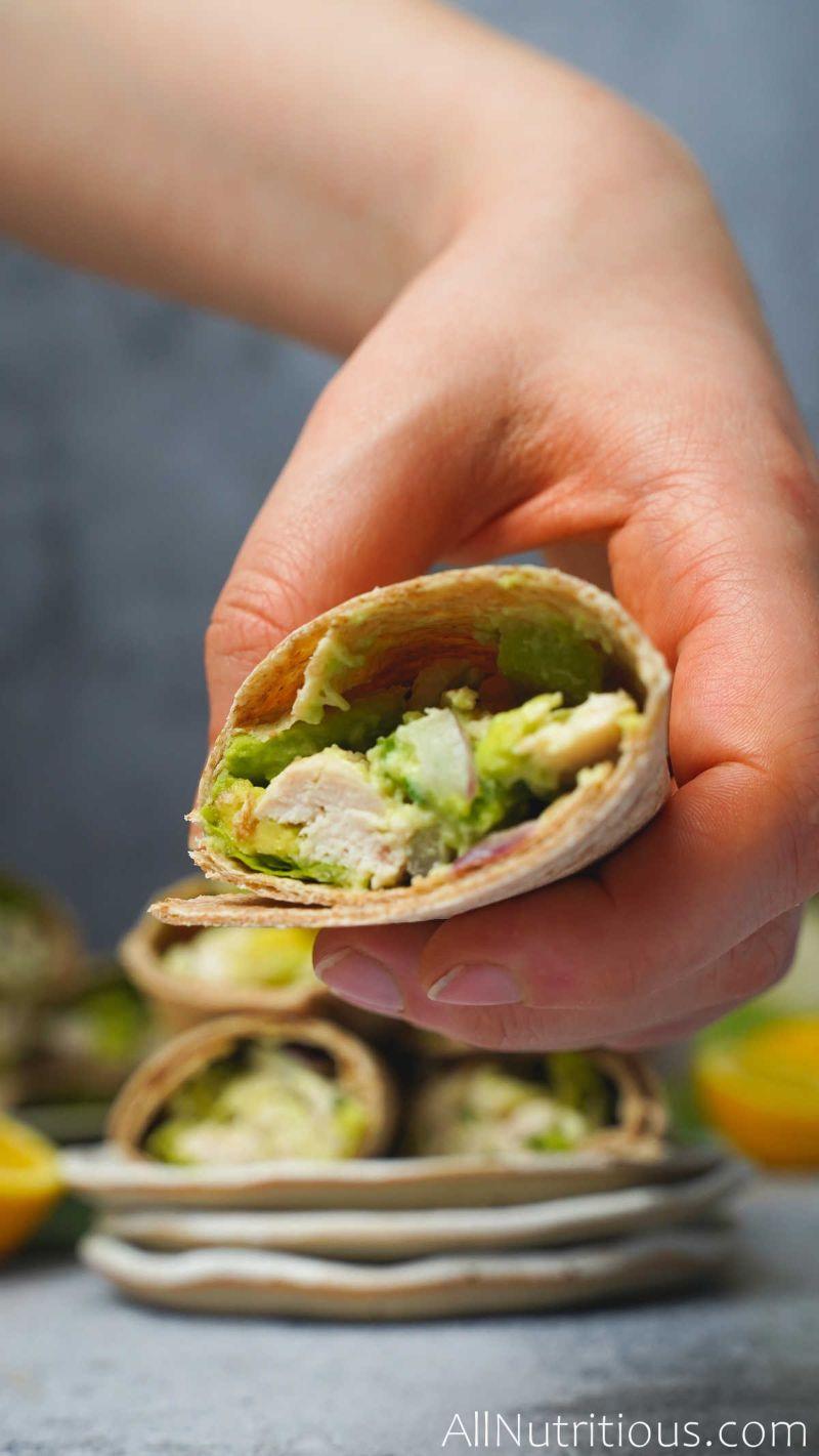 holding chicken avocado wrap