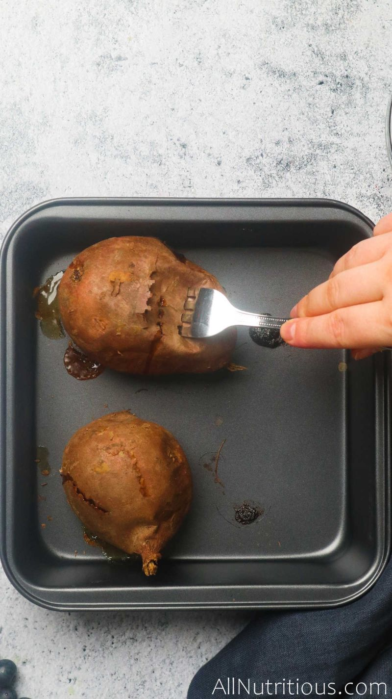 poking holes in potato with fork