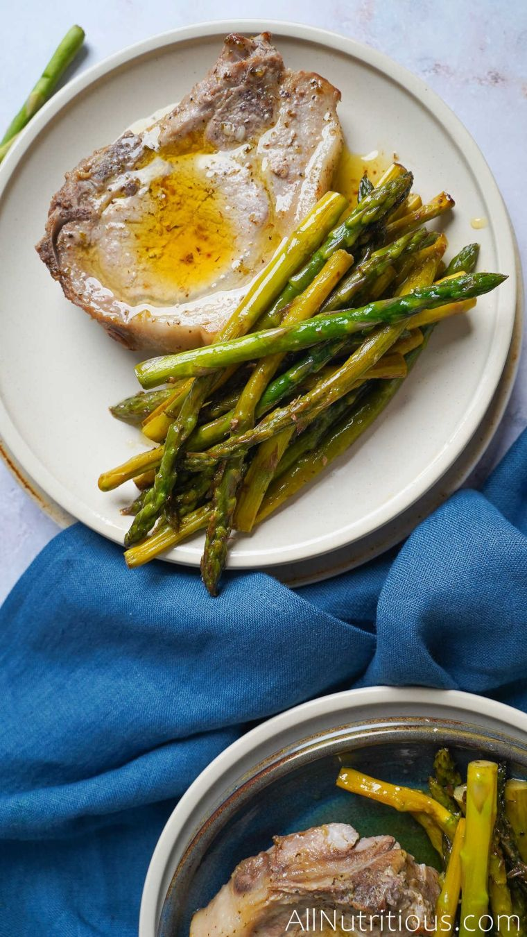 cooked pork chop and asparagus