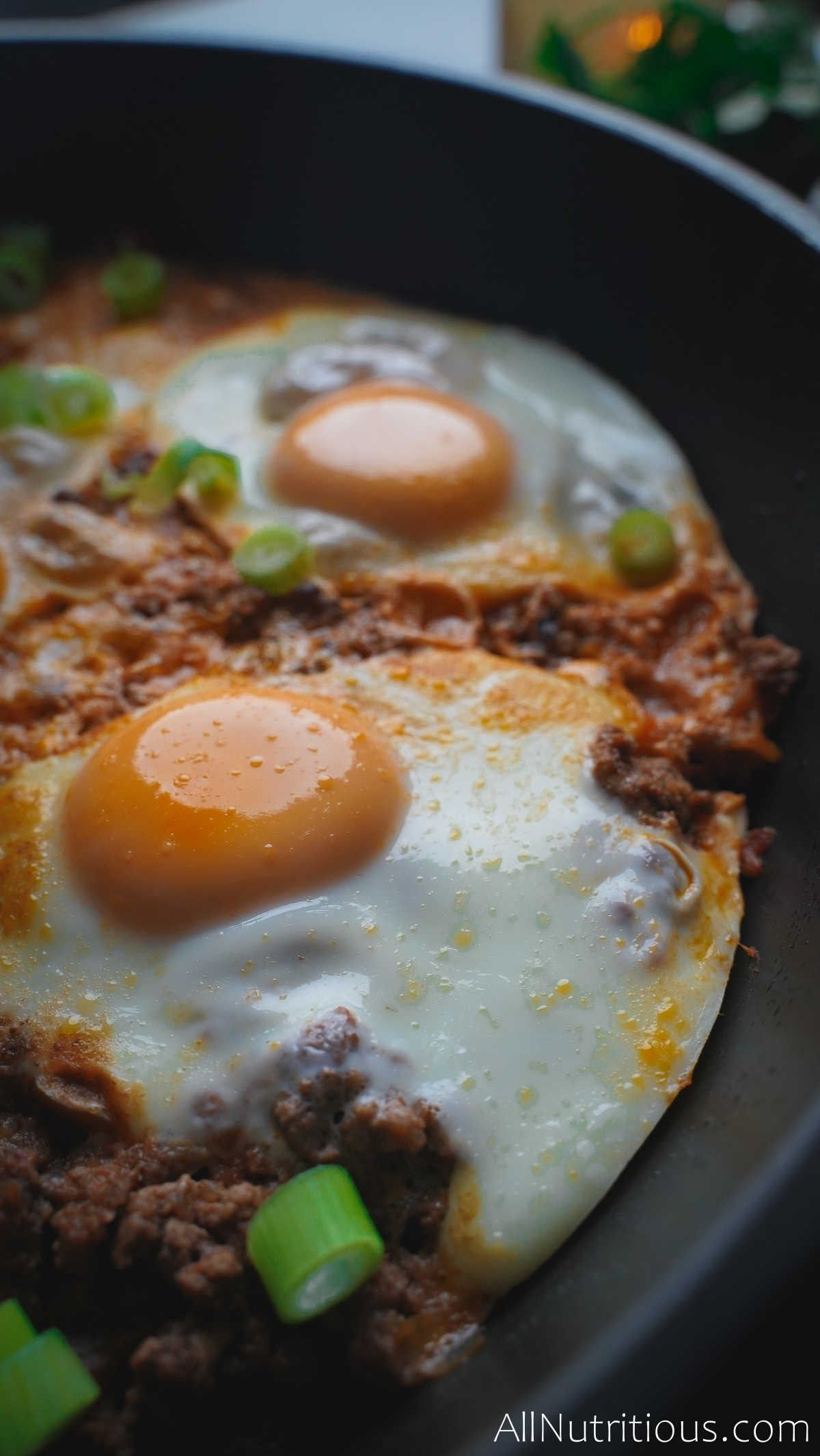 close up of egg in pan