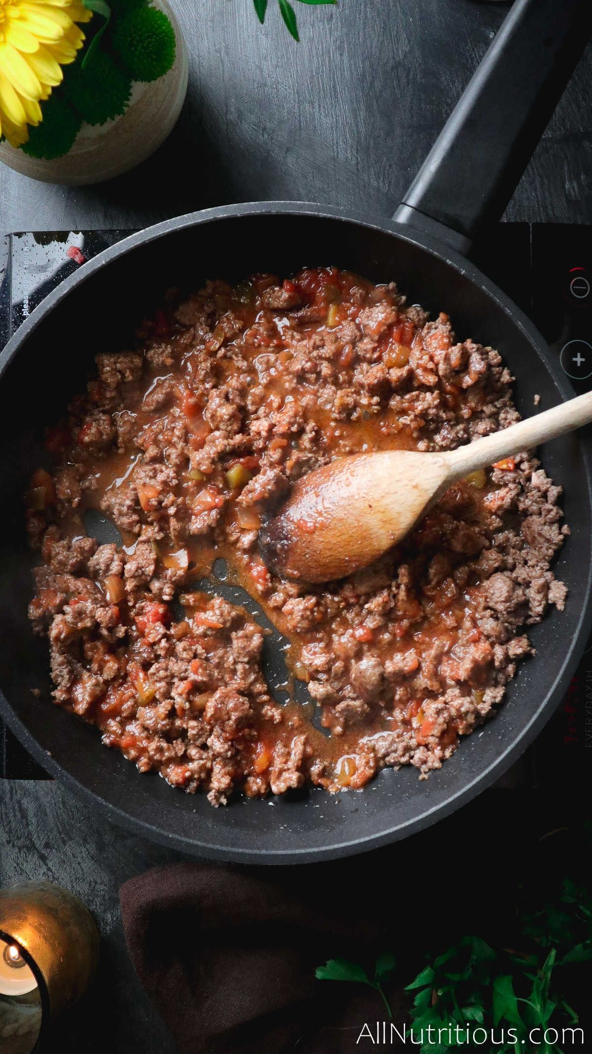 cooking meat with sauce