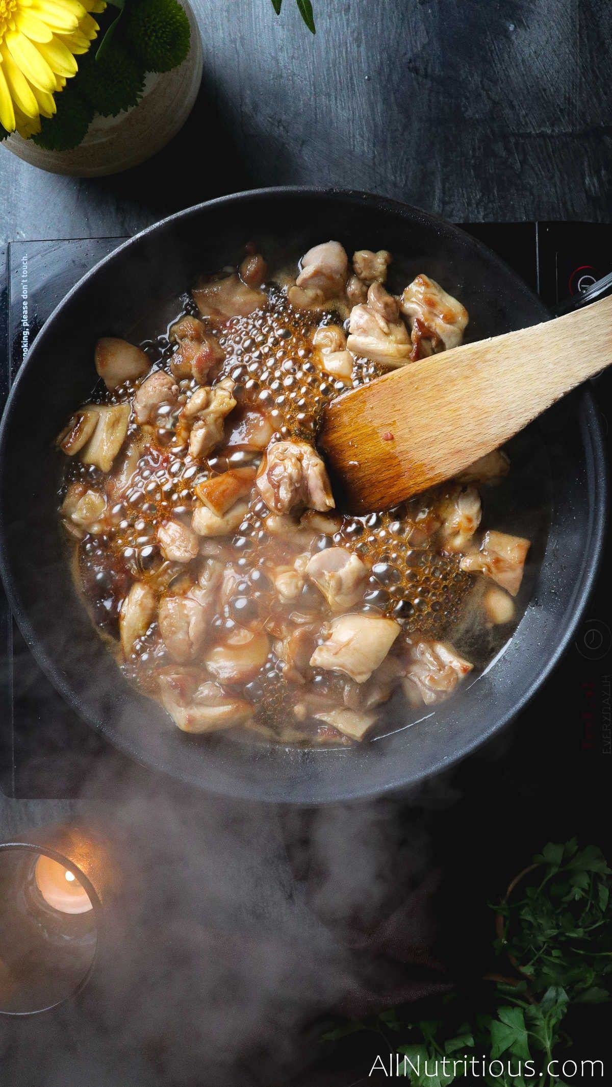 chicken in pan with sauce