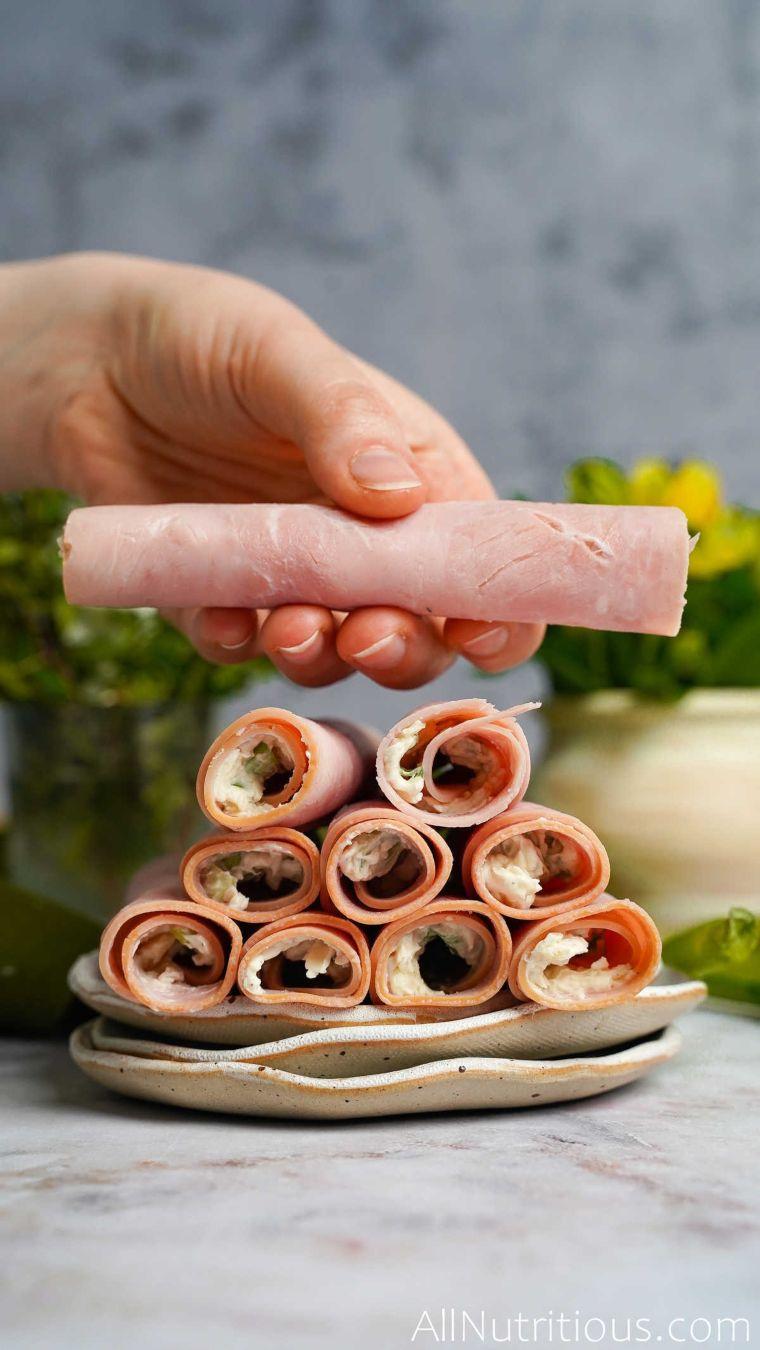 holding ham roll