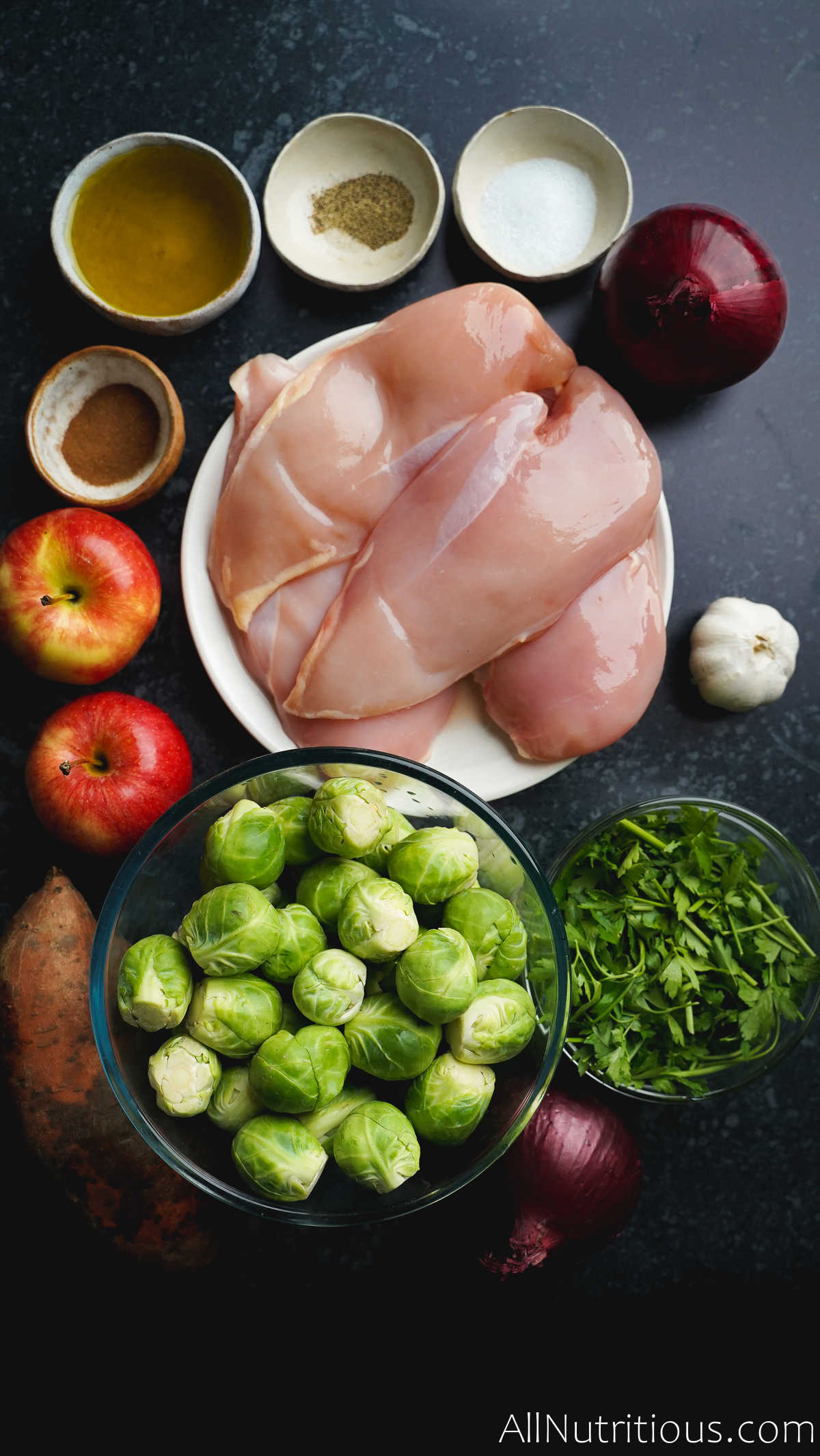raw chicken, brussels sprouts and ingredients
