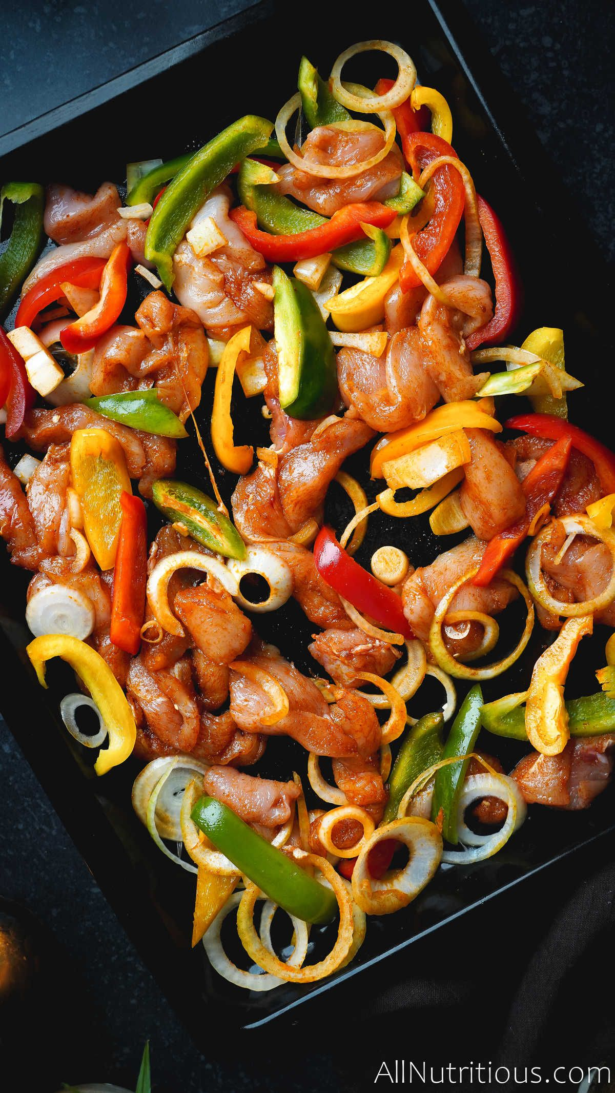 onions and peppers on sheet pan